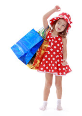 little girl in a summer dress with polka dots is on the shoulder