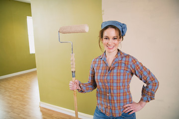 Moving: Smiling Woman Holding Paint Roller