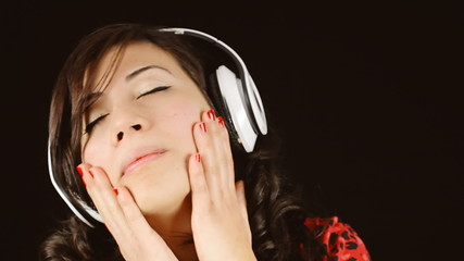 Music woman black headphones hands caress