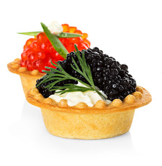 Tartlets with red and black caviar isolated on white background