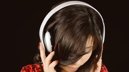 Music woman black headphones serious