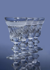 Wine glasses on blue background
