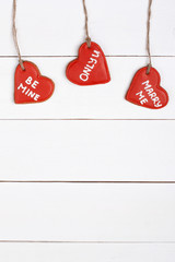 Cookie in shape of heart with words 14th february