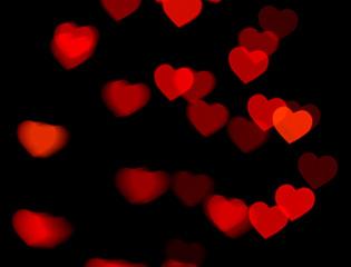 red heart bokeh on dark background