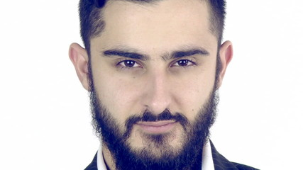 Serious young man with beard looking camera tracking shot