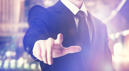 Businessman touching a touch screen