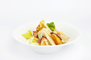 caesar salad with bacon recipe on a white background.