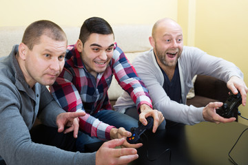 Three friends playing video games
