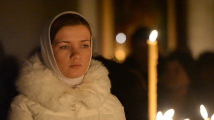 Young attractive girl in the service of the church. Russian Orth