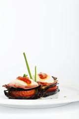 Eggplant parmigiana recipe on a white background.
