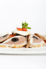 LOIN OF RABBIT with BASIL AND OLIVE recipe on a white background