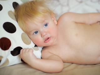 Toddler boy in bed