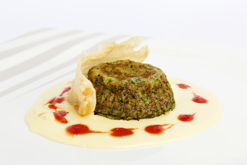 Spinach souffle with four cheese cream and parmesan crust decora