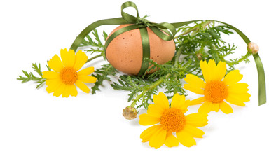 decorated egg and spring flowers