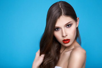 Beautiful sexy woman with evening makeup red lips long hair hand