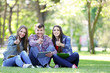 canvas print picture - Happy students sitting in park
