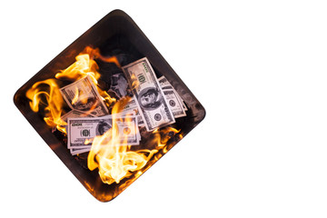 Basket with burning dollars isolated on white.