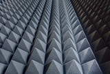 Fototapety Texture soundproof panels in perspective. Triangles of the same