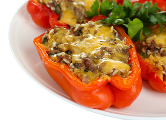 Stuffed red peppers on plate close up