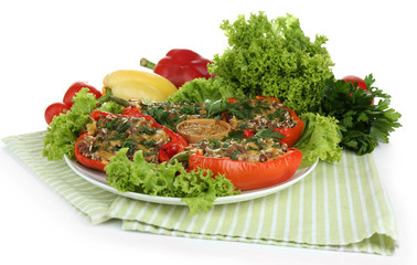 Stuffed red peppers on plate on napkin isolated on white