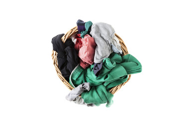 Dirty clothes loundry in wicker basket, zenithal cut, isolated o