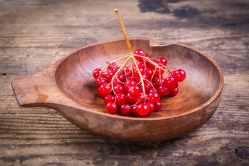 bunch of viburnum in wooden plate