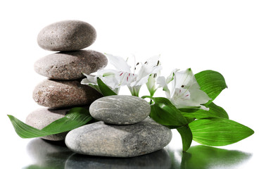 Spa stones with flowers isolated on white