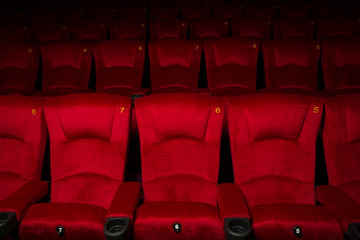 Empty rows of red theatre or movie seats