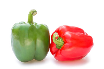 green and red bell peppers on a white background