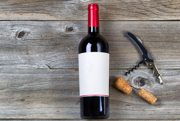 Red wine with Opener on Rustic wood