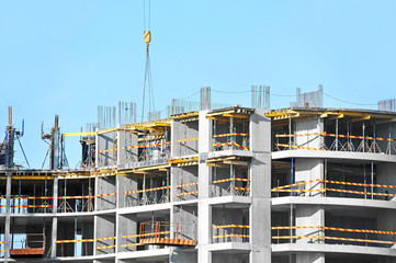 Building construction site work against blue sky