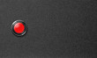 start red push button on black plastic background - 78028947