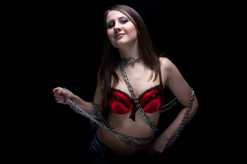 Image of young woman in bra with chain