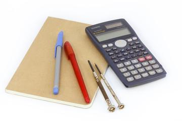 Engineer equipment is consist of pen, book, calculator and screw