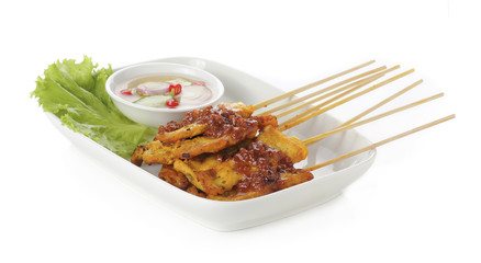 Grilled pork satay with sauce on plate