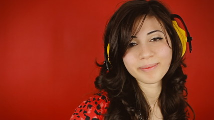 Music woman red headphones caress kiss seduce