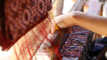 detail of traditional thai loom at work