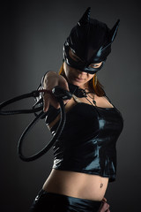 woman cat with a whip in hand