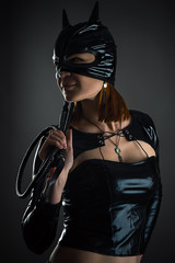 portrait cat woman with a whip in hand