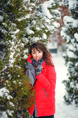 Attractive girl, red coat posing. winter snow