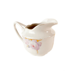 Porcelain Gravy boat with floral ornament isolated over white