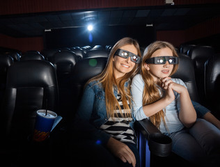 Mother And Daughter Watching 3D Movie In Theater