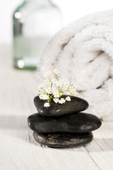 spa stones and towel