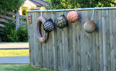 Buoys and a life ring hanging on the fence