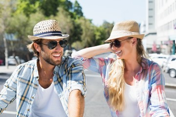 Attractive happy couple wearing sunglasses