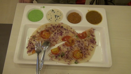 indian breakfast food in plastic plate on table