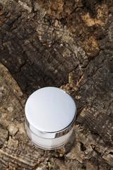 collagen bottle on wooden bark