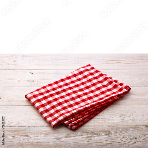 Papiers peints Cuisine Top view of checkered tablecloth on white wooden table.