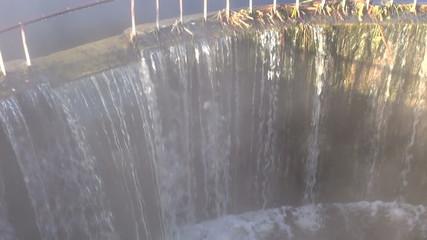 river dam water splash  in morning light and fog