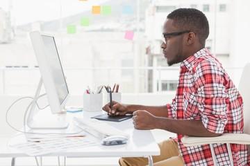 Focused designer using digitizer and computer